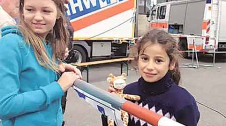 For a 9-year-old refugee in Munich: Food, clothes, smiles, a baby giraffe