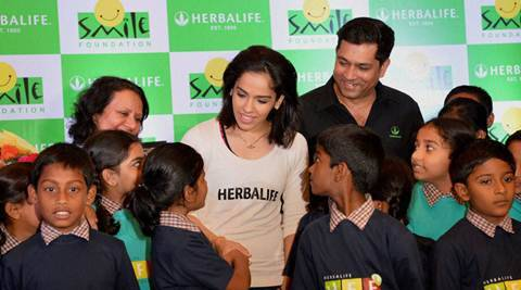 Bengaluru: Badminton star Saina Nehwal interacts with school kids during the launch of third phase of CASA Herbalife programme with Smile Foundation in Bengaluru on Thursday. PTI Photo by Shailendra Bhojak(PTI9_3_2015_000145B)