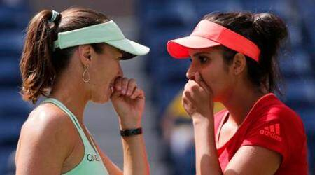 Martina Hingis of Switzerland (L) and Sania Mirza of India discuss strategy as they play Casey Dellacqua of Australia and Yaroslava Shvedova of Kazakhstan during the women's doubles final match at the U.S. Open Championships tennis tournament in New York, September 13, 2015. REUTERS/Eduardo Munoz