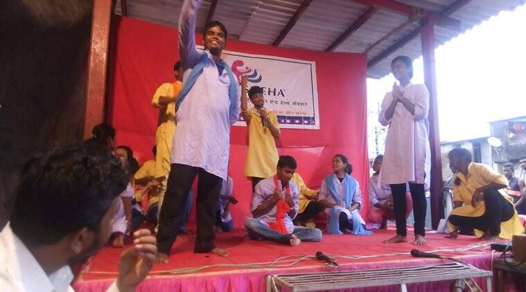 Youth volunteers of SNEHA enacting a street play on domestic violence, a part of their sensitisation programs in a Mumbai slum.
