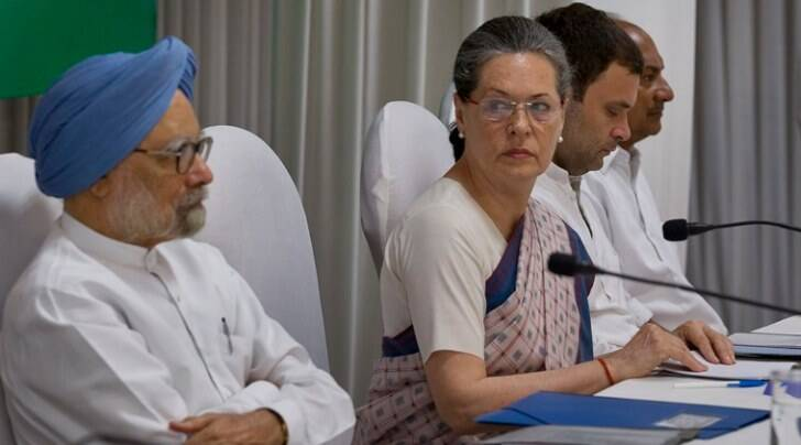 Congress president Sonia Gandhi with former PM Manmohan Singh and Vice President Rahul Gandhi at the CWC meeting in New Delhi (PTI photo)