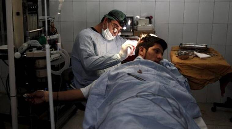 Plastic surgeon Abdul Ghafar Ghayur performs surgery on a patient at Aria City Hospital, in Kabul, Afghanistan (Source: Reuters)