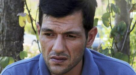 Migrant crisis: Father of drowned Syrian toddler returns to Kobani for burial