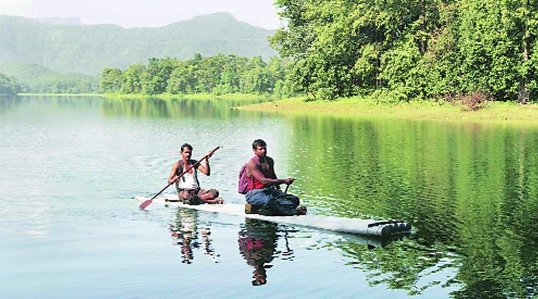 Ravindra and Pramod cross a river on a self-made raft to get to a school in Shahapur taluka in Thane district. Deepak Joshi