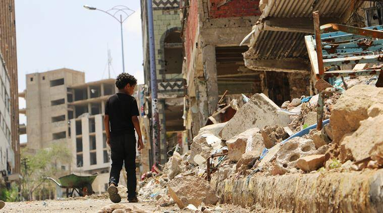 FILE PHOTO: A boy walks near the rubbles of houses destroyed during fighting between tribal fighters and Shiite rebels known as Houthis in Taiz, Yemen, Sunday, Aug. 23, 2015. Yemen's conflict pits the Iran-allied Houthis and troops loyal to the former president, Ali Abdullah Saleh, against an array of forces including southern separatists, local and tribal militias, Sunni Islamic militants as well as troops loyal to President Abed Rabbo Mansour Hadi. (AP Photo/Abdulnasser Alseddik)