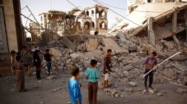Boys gather in front of the rubble of a house destroyed by a Saudi-led airstrike in Sanaa, Yemen, Tuesday, Sept. 8, 2015. (AP Photo/Hani Mohammed)