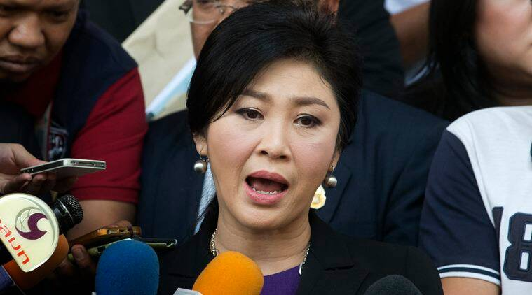 Thailand's former Prime Minister Yingluck Shinawatra talks to reporters before she leaves Bangkok's Criminal Court, Thailand, Tuesday, Sept. 29, 2015. Yingluck filed a criminal case at the court to counter-sue the country's attorney-general over the handling of her prosecution in connection with a subsidy scheme for rice farmers, which ran up huge losses. (AP Photo/Sakchai Lalit)