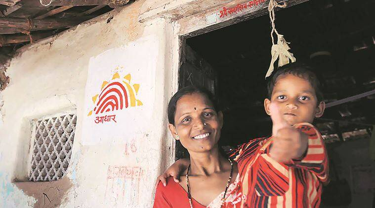 """MOTHAR AND SON RANJANA AND HITESH SONAWANE (5),WHO BECAME THE FIRST INDIANS to get a unique IID under the AADHAR project at the hands of prime minister manmohan singh and sonia gandhi at their homestead at tembhli village on wednesday"""