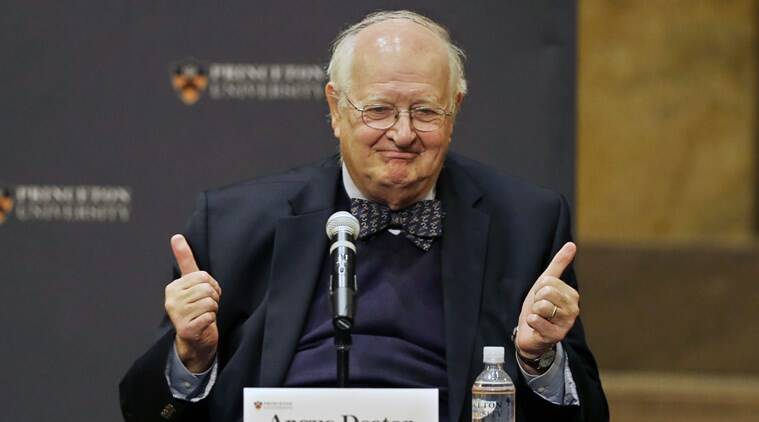 Angus Deaton gestures at a gathering at Princeton University after it was announced that he won the Nobel prize in economics (AP photo)