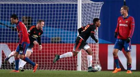 Manchester United's Anthony Martial, second right, celebrates with Wayne Rooney after scoring his side's first goal during the Champions League Group B soccer match between CSKA Moscow and Manchester United at the Arena Khimki stadium in Moscow, Russia, on Wednesday, Oct. 21, 2015. (AP Photo/Ivan Sekretarev)