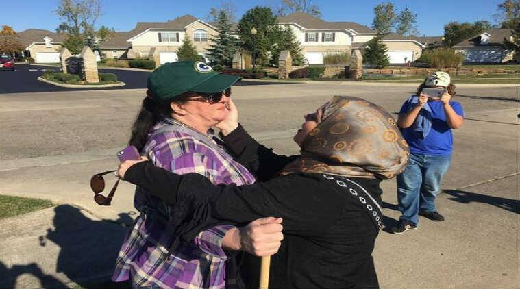 Cynthia DeBoutinkhar hugging anti-Muslim protester Annie outside Noor Islamic Cultural Centre