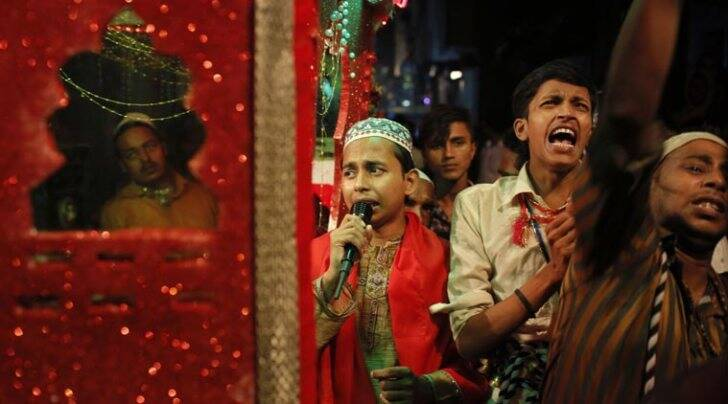 People praying during the Ashura procession in Dhaka, Bangladesh (AP photo)