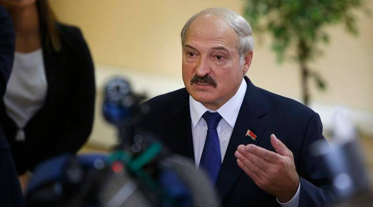 Belarusian President Alexander Lukashenko speaks to media at a polling station after voting during the presidential election in Minsk, Belarus, Sunday, Oct. 11, 2015. A presidential election was under way Sunday in Belarus, where authoritarian leader Alexander Lukashenko faced no serious competition and was expected easily to win a fifth term. The opposition called for a boycott of the vote. (AP Photo/Sergei Grits)