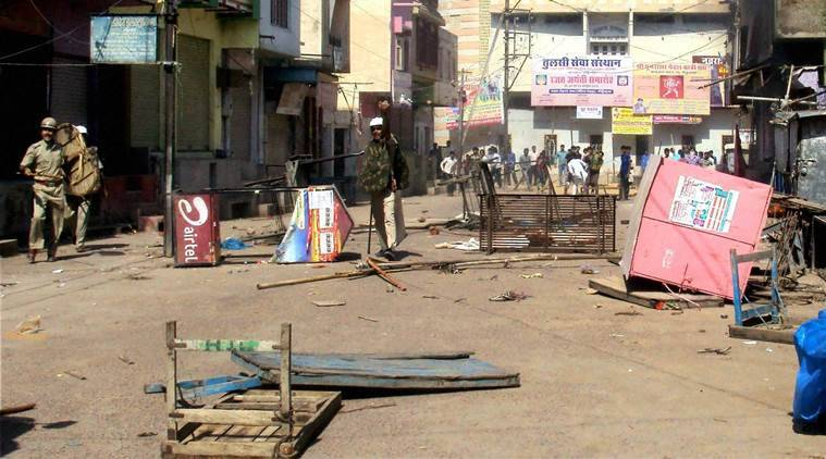 Bikaner : Police control people after a two communities clashed in Sri Dungargarh, Bikaner on Saturday . PTI Photo(PTI10_24_2015_000196B)