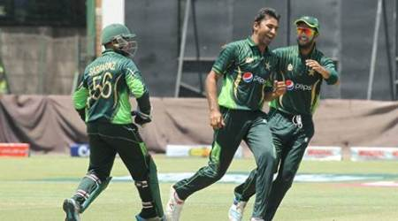 HARARE: Pakistan  bowler  Bilal Asif,centre, celebrates the wicket of Zimbabwean batsman Sirkanda Raza Butt during  the One Day International Cricket match between Zimbabwe and Pakistan  in Harare, Monday, Oct. 5, 2015.AP/PTI(AP10_5_2015_000132B)