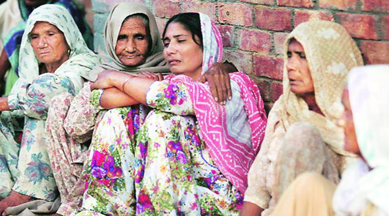 The grieving family members of Kishan Singh, who was killed in police firing, at Naimiyewala village on Thursday. Gurmeet Singh