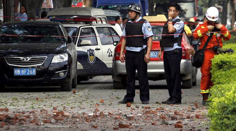 Chinese police officers stand at the scene of an explosion in Liucheng county in southern China's Guangxi Zhuang Autonomous Region Thursday, Oct. 1, 2015. (Source: AP photo)