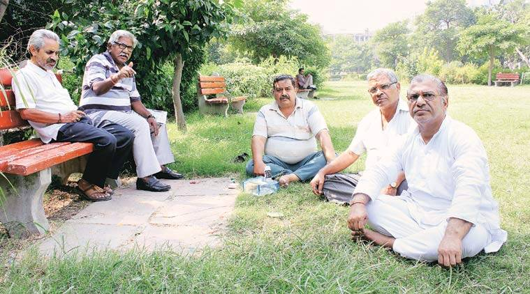 "Rashtra Prakash (above, far left), northern region head of the Gau-Raksha Vibhag, with members of his group. ""We want a Central law against cow slaughter,"" he says."