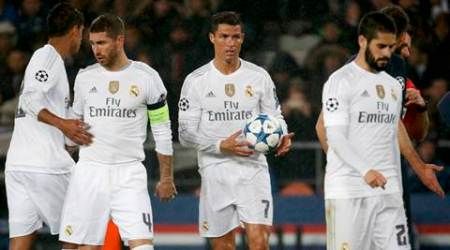 Real Madrid's Cristiano Ronaldo (2ndR) holds the ball as he stands between Real Madrid's Sergio Ramos (2ndL) and Isco (R) during their Champions League Group A soccer match against Paris Saint Germain at the Parc des Princes stadium in Paris, France, October 21, 2015.    REUTERS/Charles Platiau