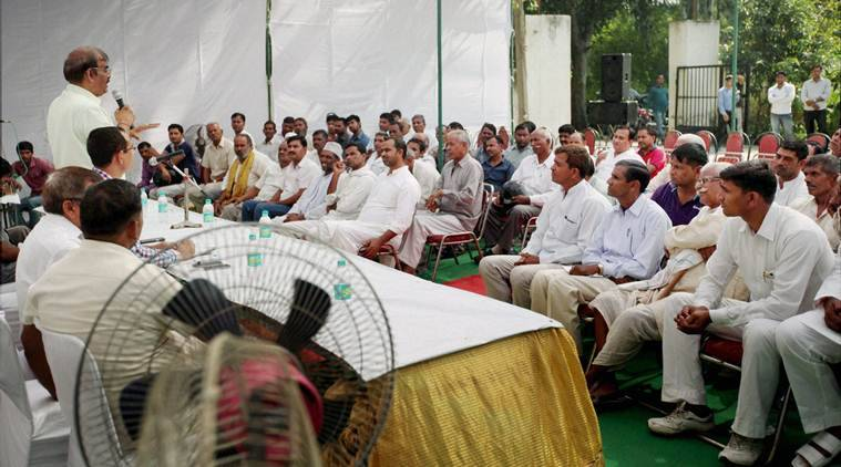 Dadri: Villagers attend a meeting organised for peace and harmony in Dadri on Wednesday. PTI Photo (PTI10_7_2015_000275A)