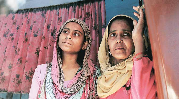 Akhlaq's daughter and sister at his residence in Bisara village, in Dadri on Thursday. (Source: Express Photo by Gajendra Yadav)