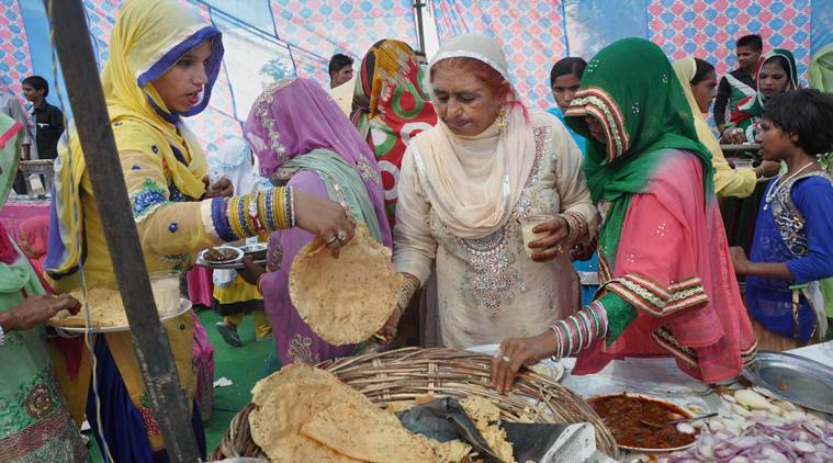 Dadri : Guests and villagers attend Muslim weddings in Bishada village in Dadri on Sunday . PTI Photo (PTI10_11_2015_000178A)