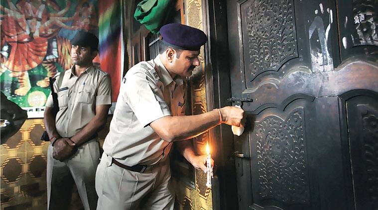 A policeman seals the room where the attack took place in Sunpedh. (Source: Express photo by Oinam Anand)