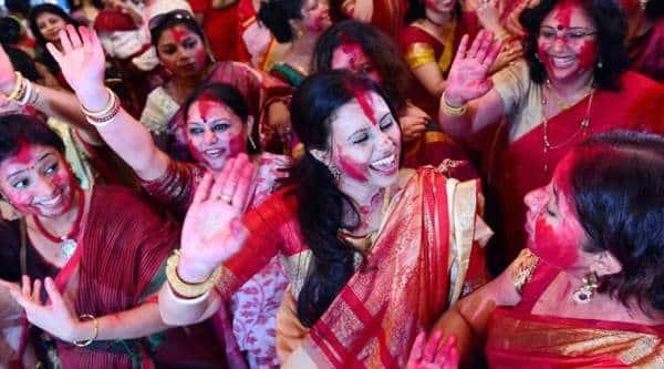 Mumbai: Bengali women play with vermilion on the Dashmi of Durga Puja festival in Mumbai on Thursday. PTI Photo by Mitesh Bhuvad (PTI10_22_2015_000213B)