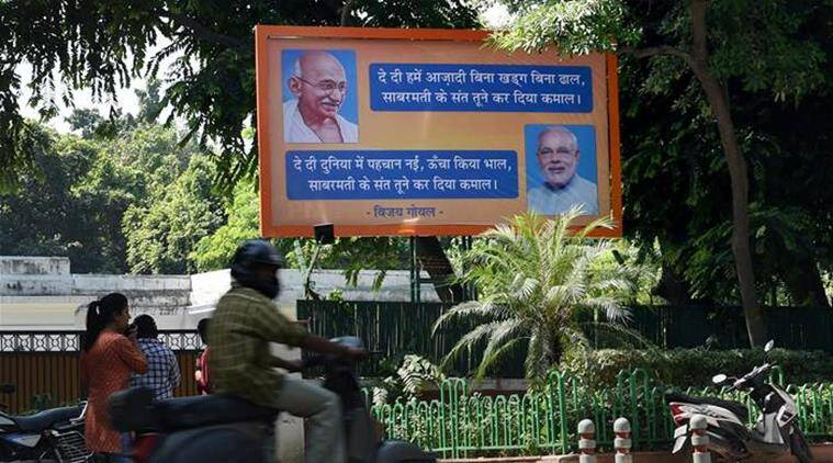 "New Delhi: A bill board put up by BJP MP Vijay Goel at his residence presents Prime Minister Narendra Modi as ""Sabarmati ka Sant"" like Mahatma Gandhi in New Delhi on Thursday. PTI Photo by Manvender Vashist  (PTI10_1_2015_000069B)"