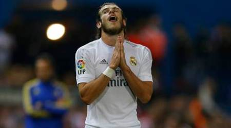 Real Madrid's Gareth Bale reacts during a Spanish La Liga soccer match between Real Madrid and Atletico Madrid at the Vicente Calderon stadium in Madrid, Sunday, Oct. 4, 2015. The match ended in a 1-1 draw. (AP Photo/Francisco Seco)