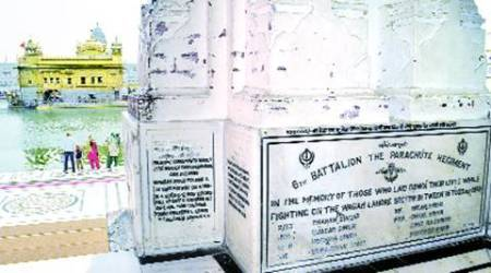 Memorial stones for martyred soldiers line walls of Golden Temple