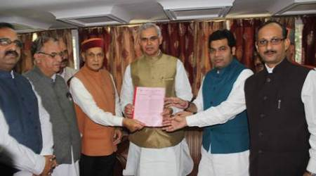 Former Chief Minister and leader of opposition Prem Kumar Dhumal with national BJP secretary and state BJP in-charge Shrikant Sharma other BJP leaders giving memorandum to Governor of Himnachal Pradesh Acharya Devvrat in against the state congress government at Rajbhawan in Shimla on Monday. Express photo by Lalit Kumar. 05.10.2015.