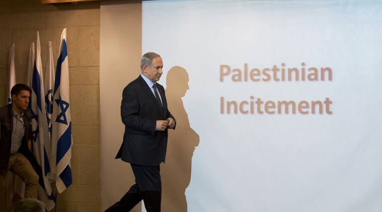 "Israeli Prime Minister Benjamin Netanyahu walks during a press conference at the Foreign Ministry in Jerusalem, Thursday, Oct. 15, 2015. Netanyahu on Thursday said he would be ""perfectly open"" to meeting with Palestinian President Mahmoud Abbas in order to end weeks of Israeli-Palestinian unrest. (AP Photo/Sebastian Scheiner)"