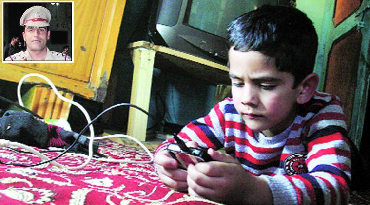 Five-year-old Aryan has not been told about the death of his father, Mohammad Altaf Dar (inset). Shuaib Masoodi
