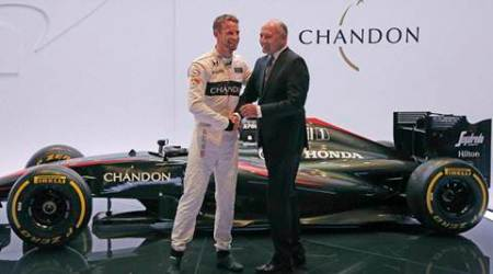 WOKING:  F1 car brand CEO Ron Dennis, right, shakes hands with Britain's McLaren F1 driver Jenson Button at left, during a presentation, in Woking, England, Wednesday, Sept. 30, 2015. McLaren announced a new sponsorship deal with champagne brand Chandon. AP-/PTI(AP9_30_2015_000180A)