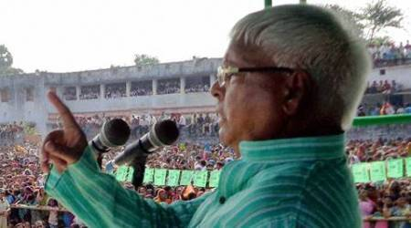 Begusarai : RJD Chief Lalu Prasad addressing an election rally in Begusarai on Wednesday. PTI Photo (PTI9_30_2015_000209B)