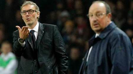 PSG headcoach Laurent Blanc, left, gestures as Real Madrid's headcoach Rafael Benitez looks on during the Champions League group A soccer match between Paris St Germain and Real Madrid at the Parc des Princes stadium in Paris, Wednesday, Oct. 21, 2015. (AP Photo/Thibault Camus)