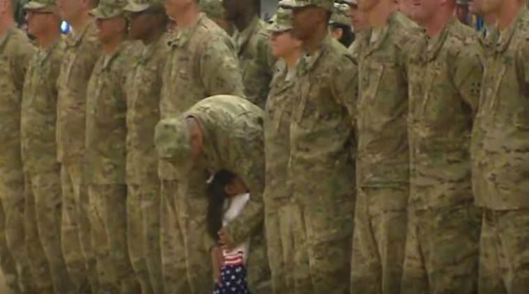 Little girl runs to hu her soldier father Source: Screenshot