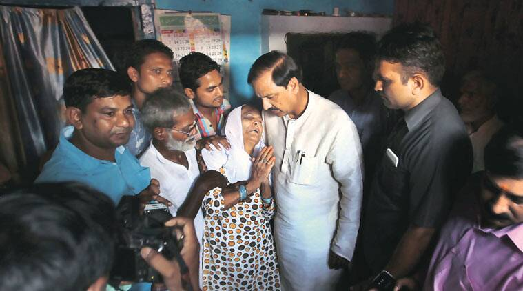 Union Minister and BJP MP from Noida Mahesh Sharma with Akhlaq's family in Dadri Friday. (Source: Express Photo by Oinam Anand)