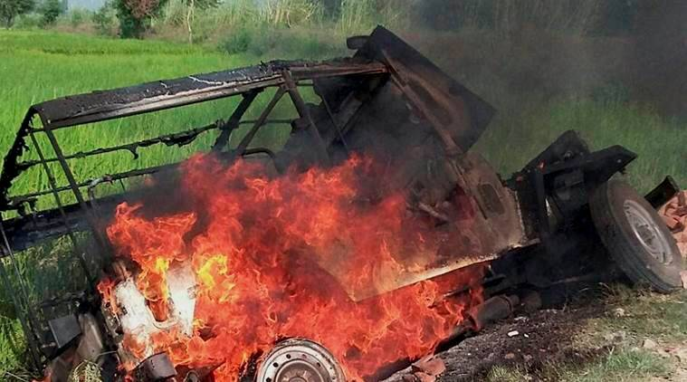 Mainpuri: A vehicle burns after villagers vandalised properties and resorted to arson in Mainpuri district on Friday over rumours of cow slaughter in the area. PTI Photo (PTI10_9_2015_000286A)