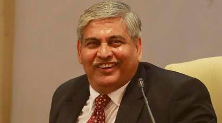 Board of Control for Cricket in India (BCCI)'s newly elected president Shashank Manohar smiles during a press conference in Mumbai, India, Sunday, Oct. 4, 2015. Manohar, a lawyer turned cricket administrator was unanimously elected president of the BCCI Sunday.(AP Photo/Rafiq Maqbool)