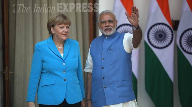 PM Narendra Modi and German Chancellor Angela Merkel on her first day of a three day India visit at the Hyderabad house in New Delhi on monday. Express Photo by Tashi Tobgyal New Delhi 051015