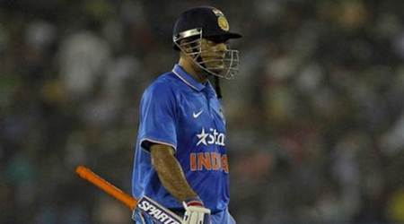India's captain Mahendra Singh Dhoni walks off the field after being dismissed by South Africa's Albie Morkel during their second Twenty20 cricket match in Cuttack, India, October 5, 2015. REUTERS/Danish Siddiqui