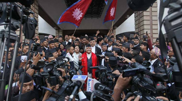 Nepal's newly-appointed prime minister Khadga Prasad Oli, center, is surrounded by journalists at the Constituent Assembly in Kathmandu, Nepal, Sunday, Oct. 11, 2015.  (Source: AP)