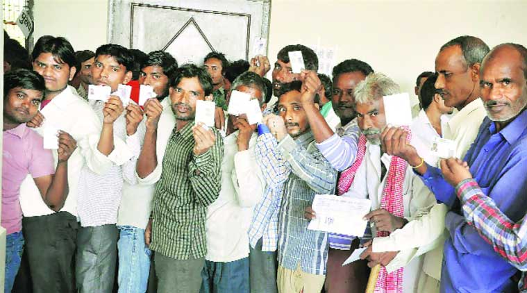Voters wait in a queue to exercise their franchise at a polling booth in Mathura on  Saturday. (PTI )