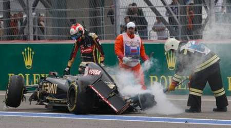Lotus driver Romain Grosjean of France leaves his car after crashing during the Formula One Russian Grand Prix at the Sochi Autodrom, in Sochi, Russia, Sunday, Oct. 11, 2015. (AP Photo/Pavel Golovkin)