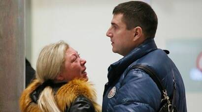 Relatives react after a Russian airliner with 217 passengers and seven crew aboard crashed, as people gather at Russian airline Kogalymavia's information desk at Pulkovo airport in St.Petersburg, Russia, Saturday, Oct. 31, 2015. Russia's civil air agency is expected to have a news conference shortly to talk about the Russian Metrojet passenger plane that Egyptian authorities say has crashed in Egypt's Sinai peninsula.(AP Photo/Dmitry Lovetsky)