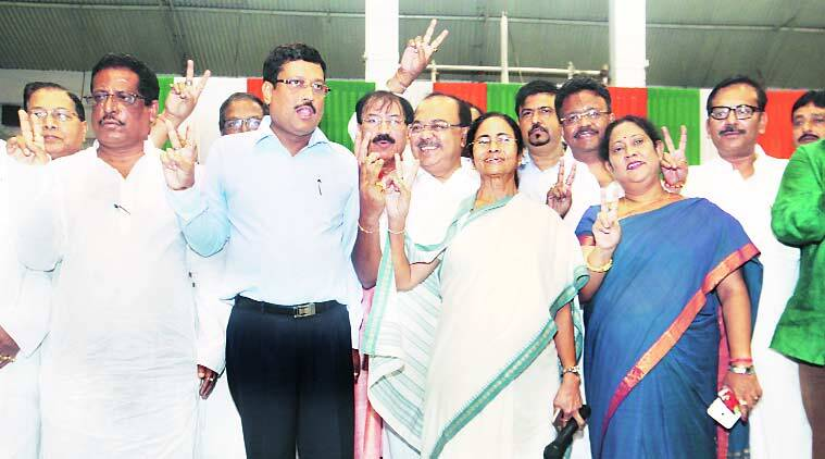 Chief Minister Mamata Banerjee with newly elected mayors, deputy mayors and chairpersons of Bidhannagar and Asansol municipal corporations at Khudiram Anusilan Kendra in Kolkata on Tuesday.  (Express Photo by Subham Dutta)