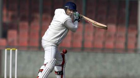 Delhi's Virender Sehwag play a shot on day one during Ranji trophy match against Odisha, at Ferozeshah Kotla stadium in New Delhi on Jan 13th 2015. Express photo by Ravi Kanojia.