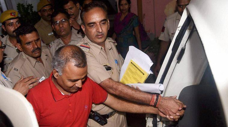 AAP MLA Somnath Bharti being taken into custody after he surrendered at the Dwarka North Police Station in New Delhi. PTI Photo by Manvender Vashist